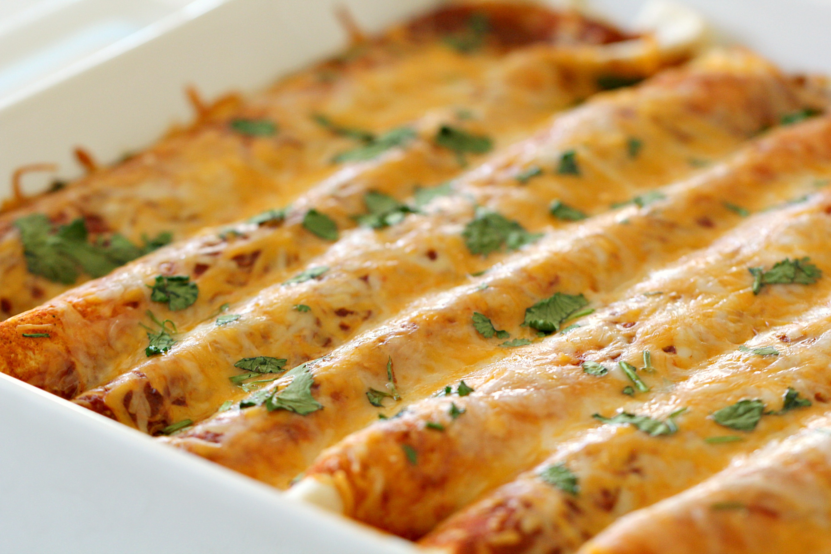 Creamy Three Bean Enchiladas in casserole dish!