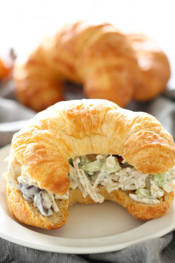 Chicken salad with grapes on croissant