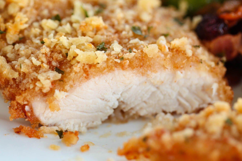 Piece of baked saltine cracker chicken sliced