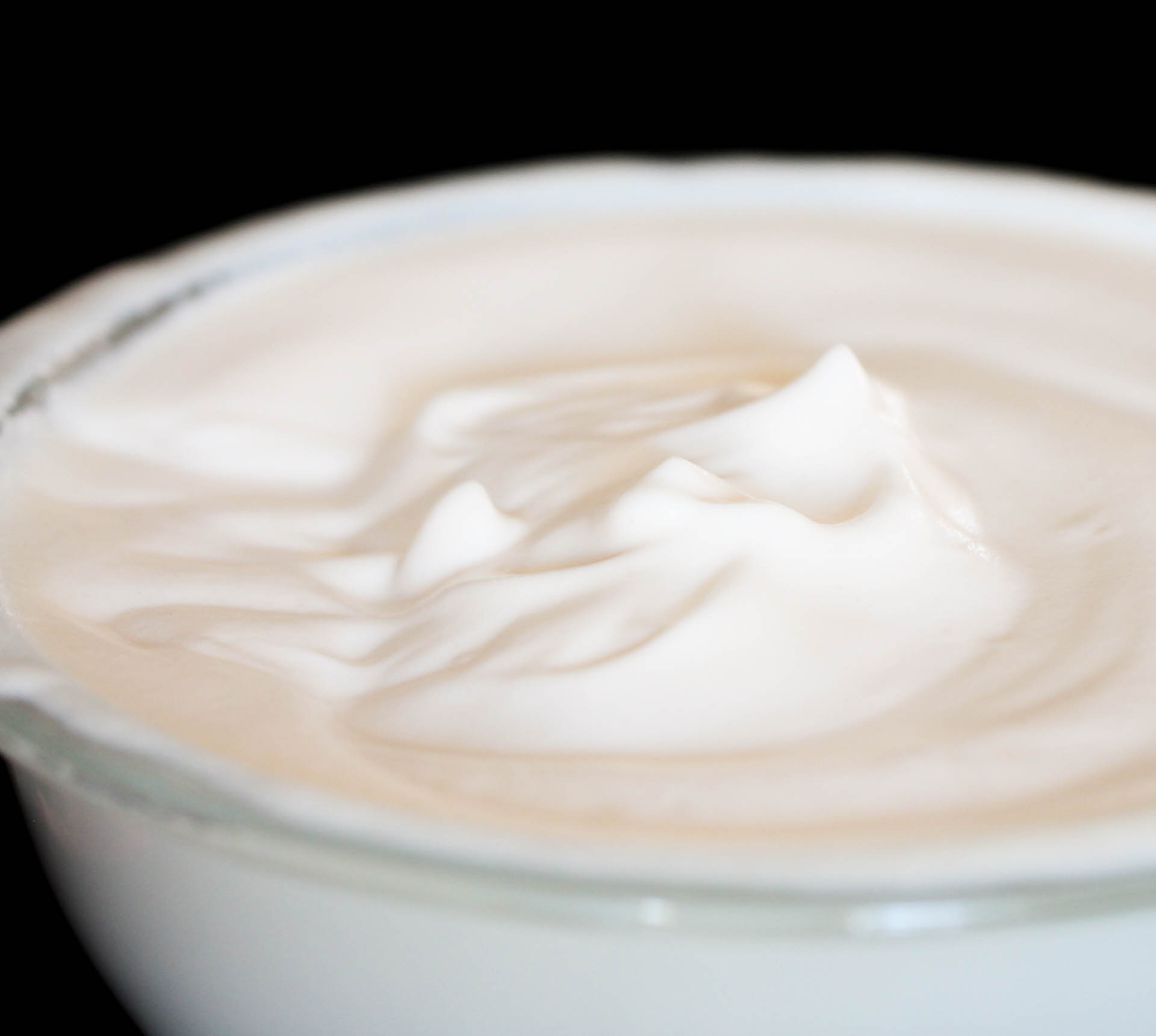 Fluffed whipped evaporated milk in a glass bowl