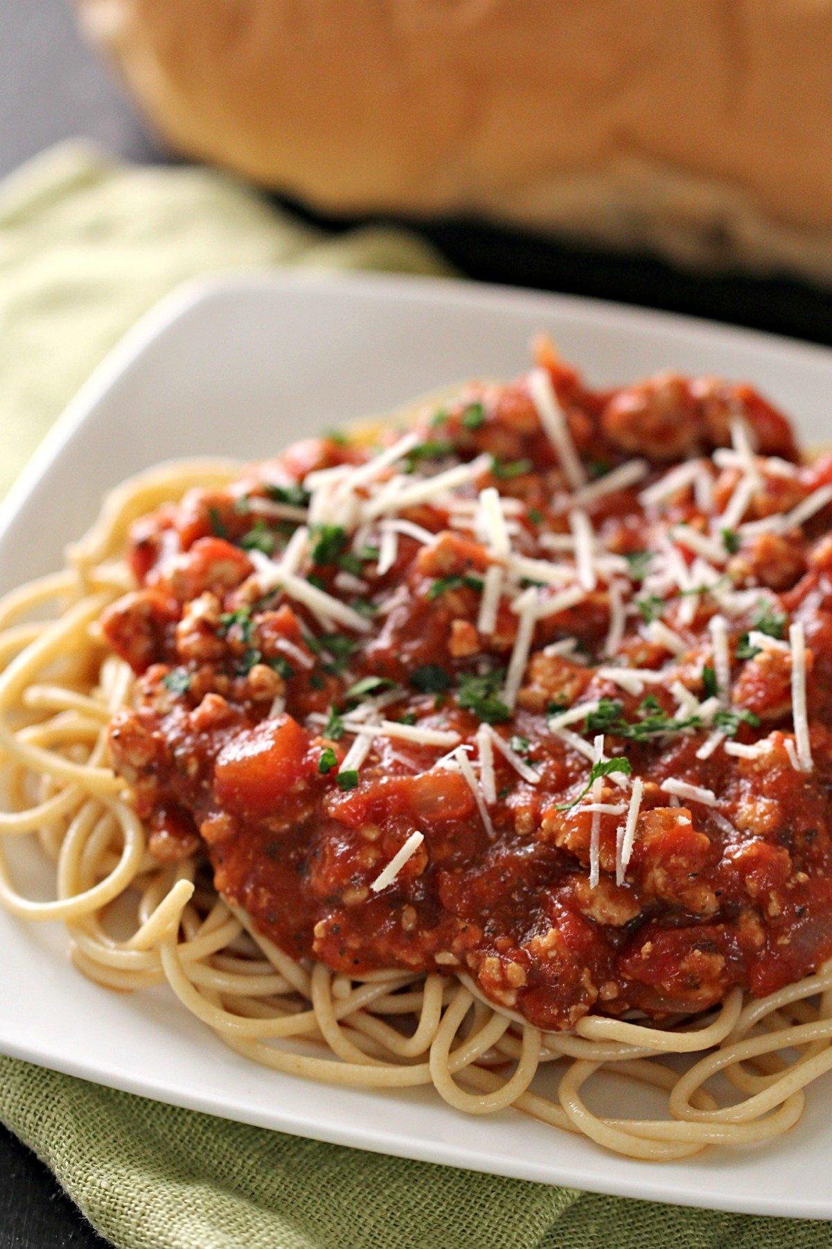 Ground turkey spaghetti sauce on spaghetti plated.