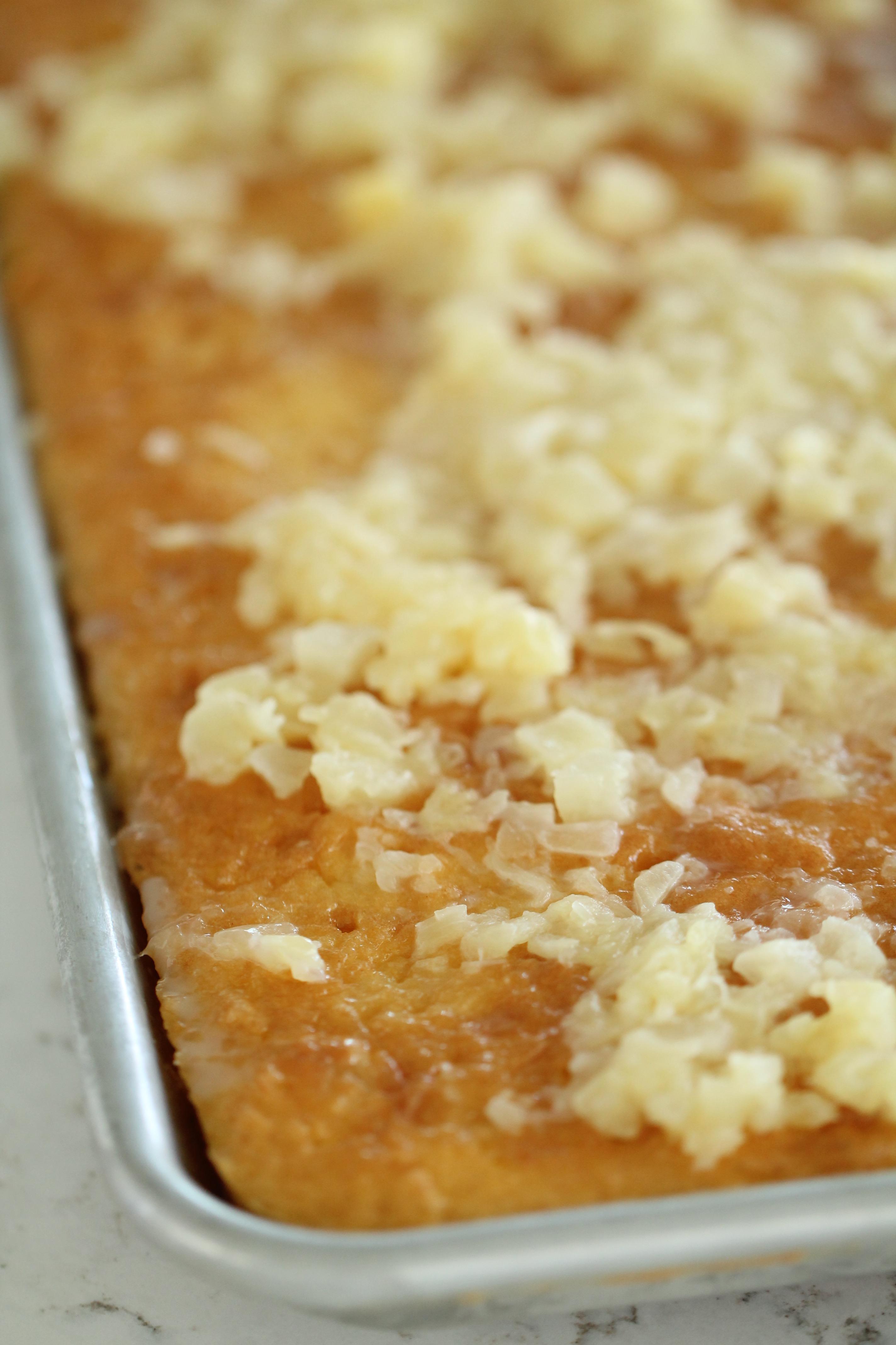 Cream of coconut poured onto yellow cake