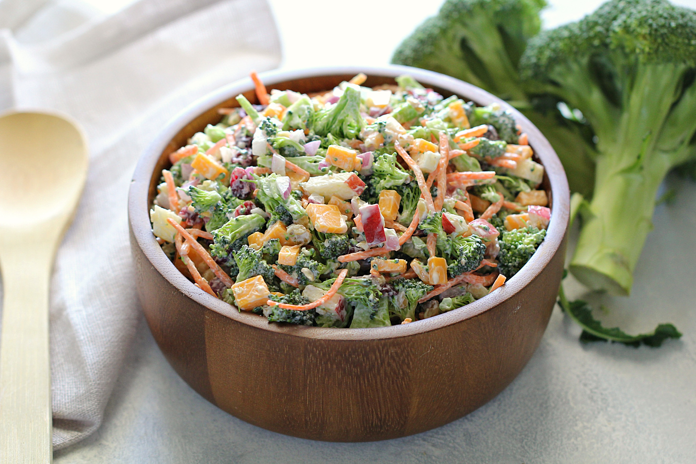 Loaded broccoli salad in wooden bowl