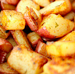 Skillet red potatoes chopped up and cooking