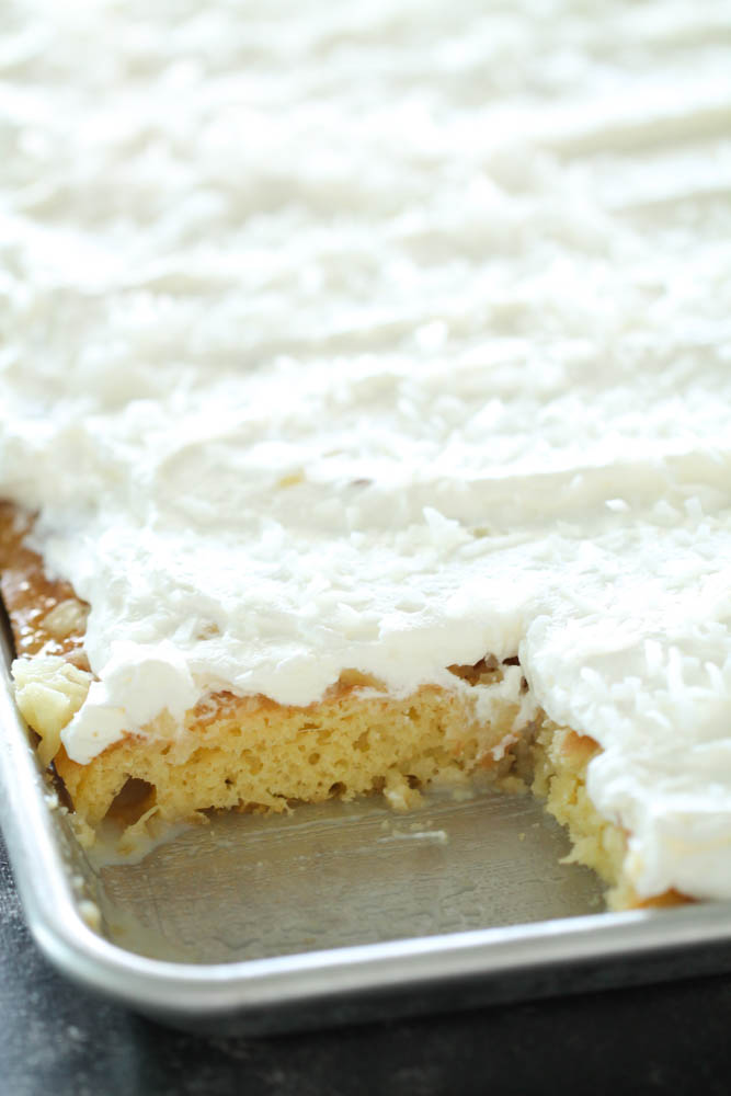 Sheet Pan Hawaiian Poke Cake with a slice missing