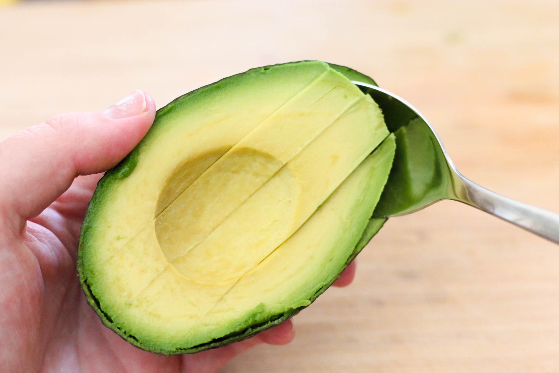 Avocado sliced in half with long vertical cuts