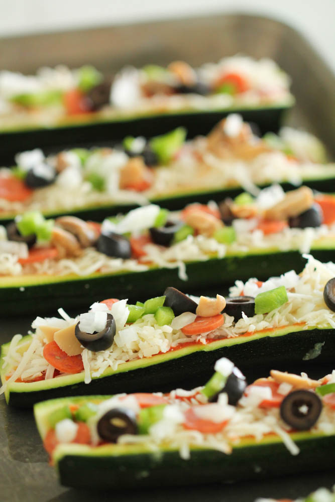 Toppings and fillings inside Zucchini boats on sheet pan