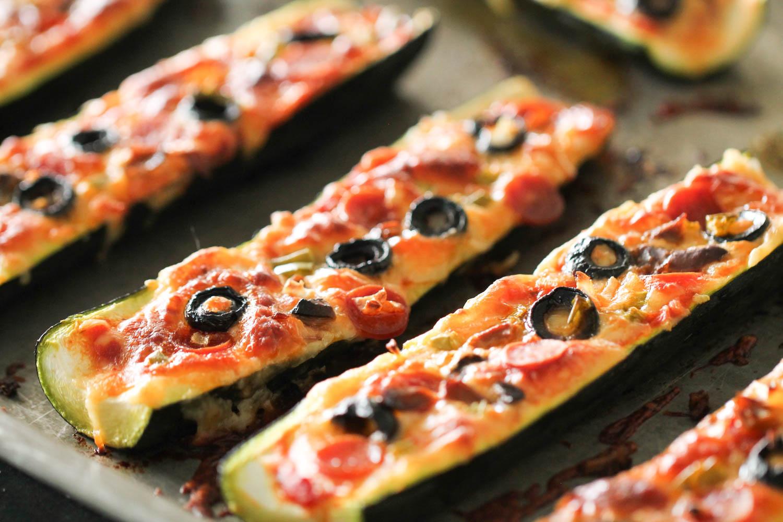 Baked Pizza Stuffed Zucchini Boats on sheet pan