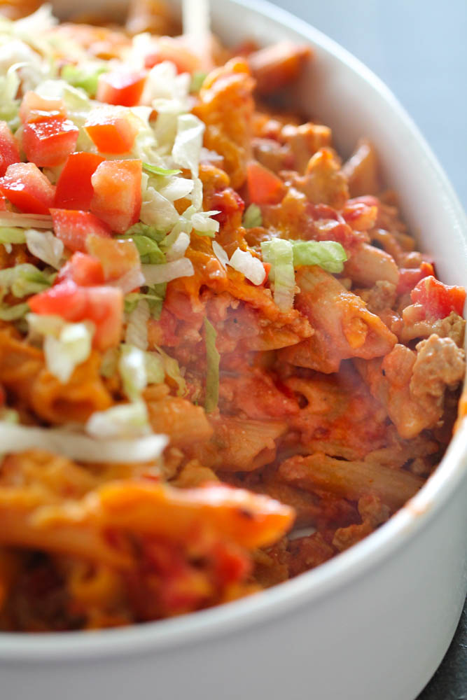 Skinny Cheeseburger Casserole topped with lettuce and tomatoes