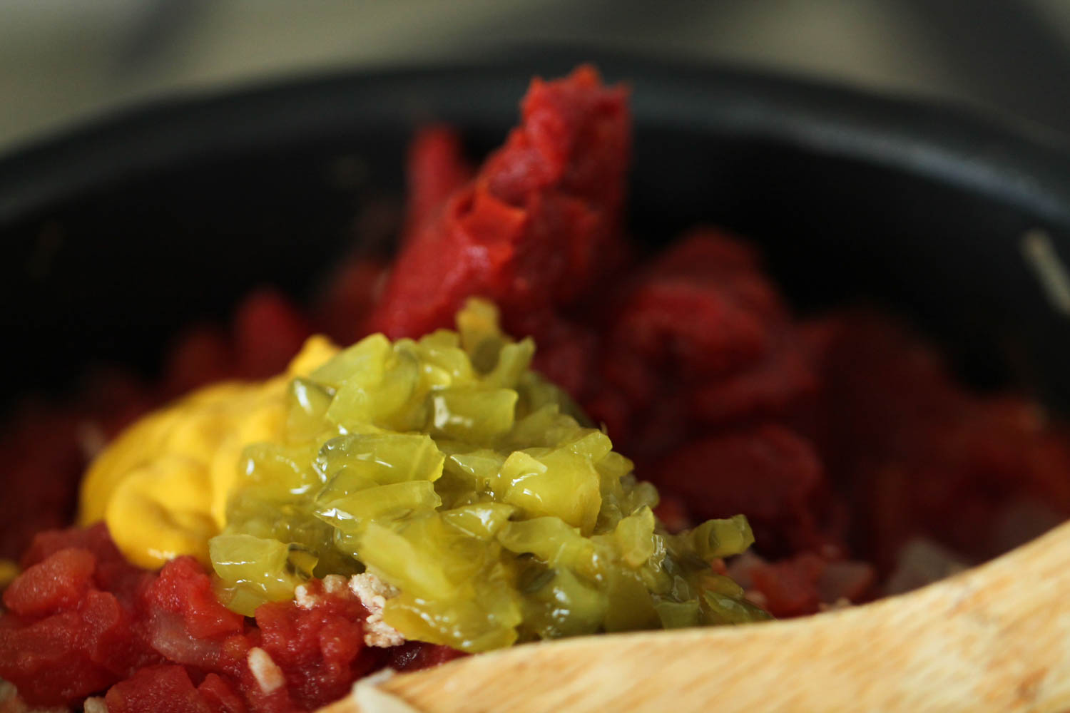 Tomato paste, mustard and pickle relish added to browned turkey