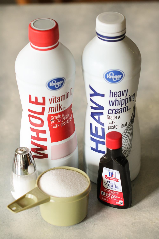 Whole milk and heavy whipping cream bottles, vanilla, sugar and salt