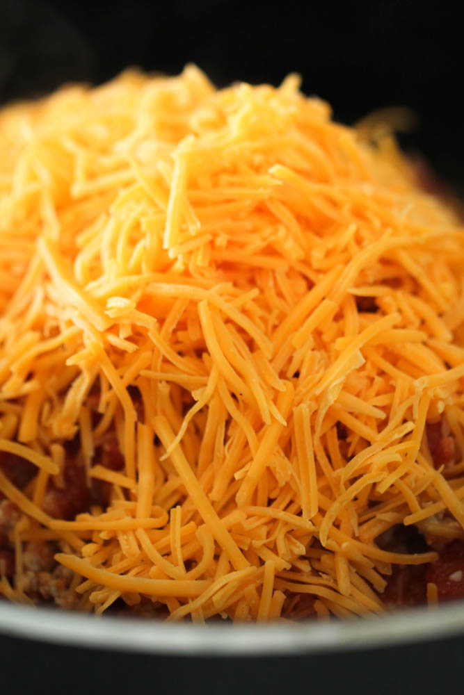 Topped mixture with shredded cheese