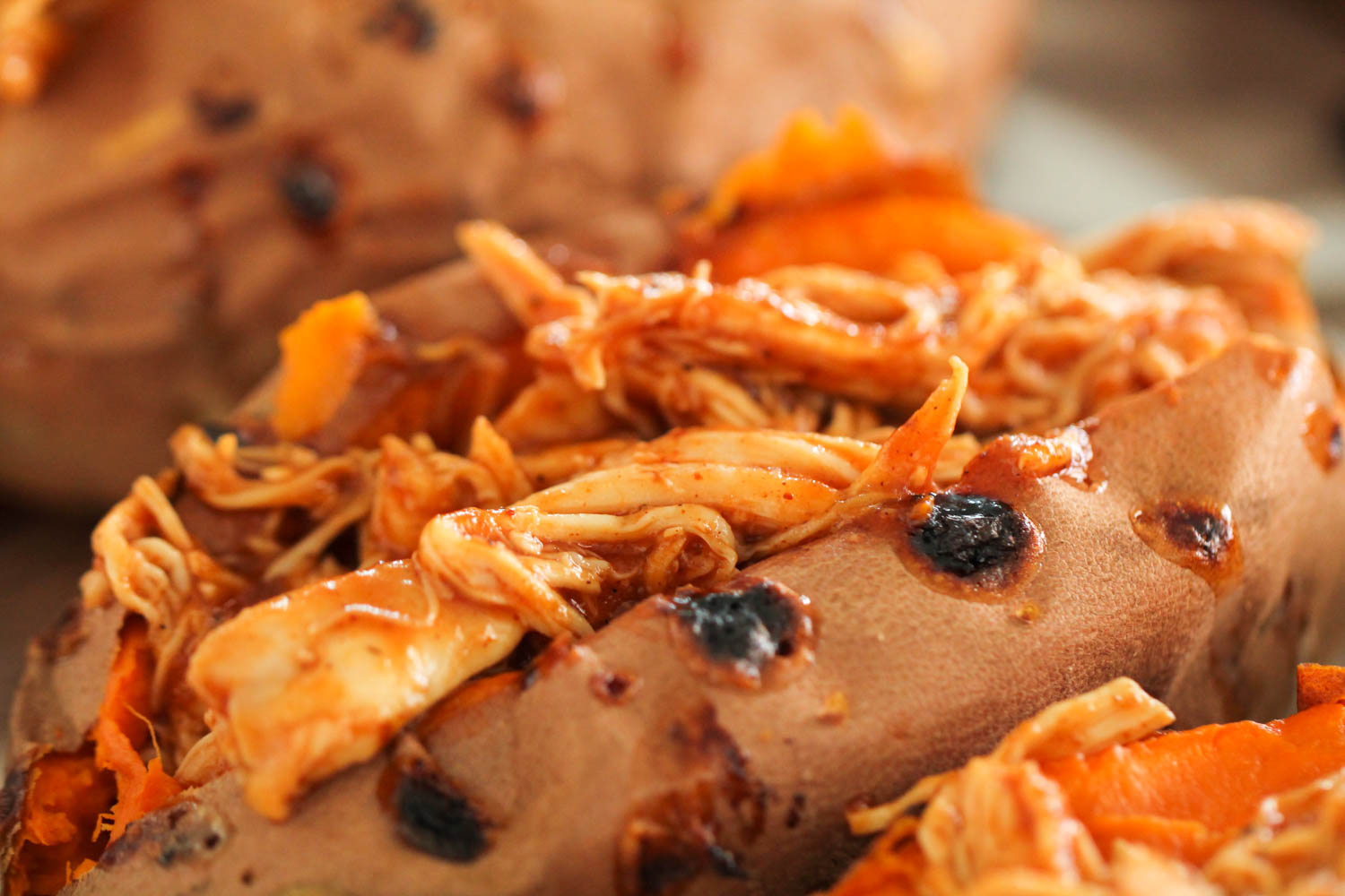 Baked Sweet Potato topped with Shredded BBQ Chicken