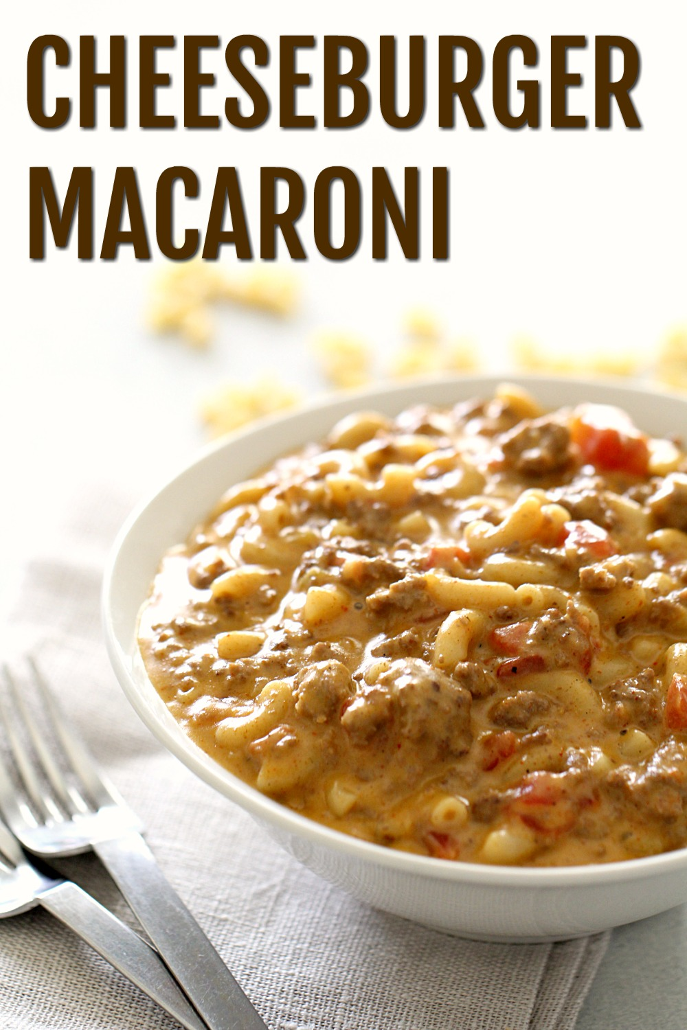 Cheeseburger Macaroni in a white bowl with a fork