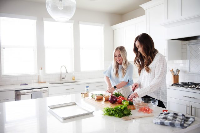 Camille and Lauren preparing food in a kitchen