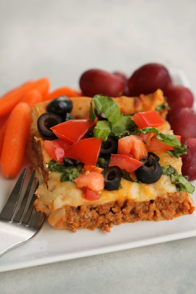 Slice of Crescent Roll Burrito Bake on a plate with a fork