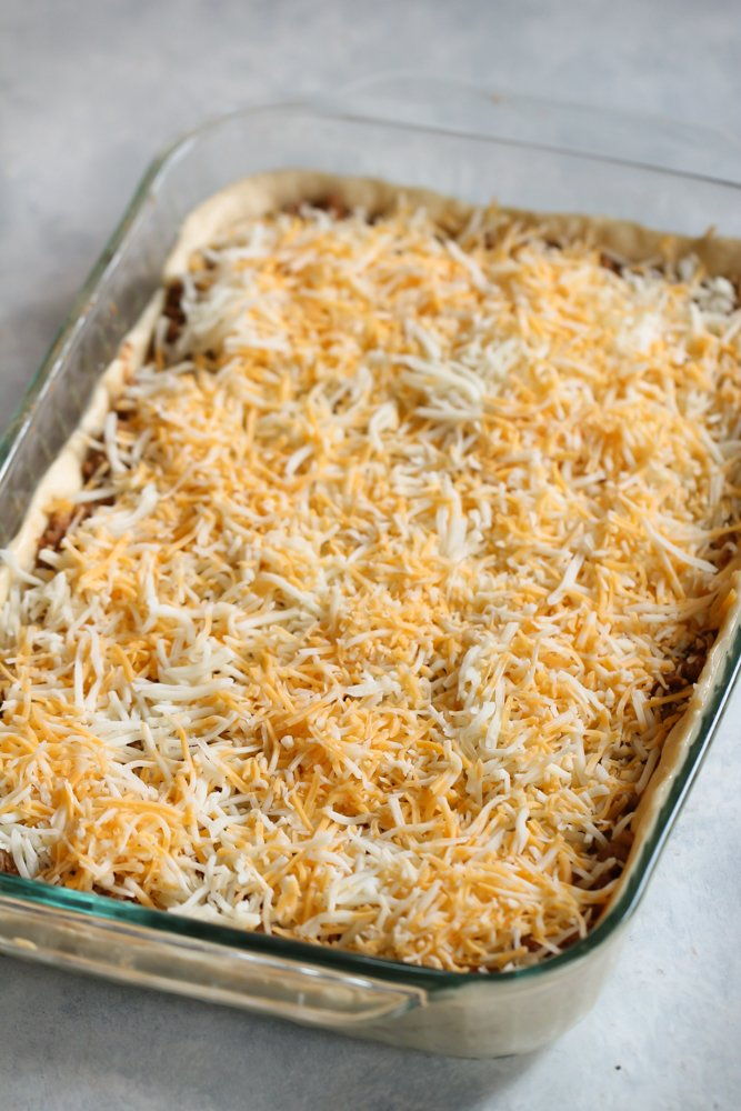 Unbaked Crescent Roll Burrito Bake in a 9x13 Glass Dish