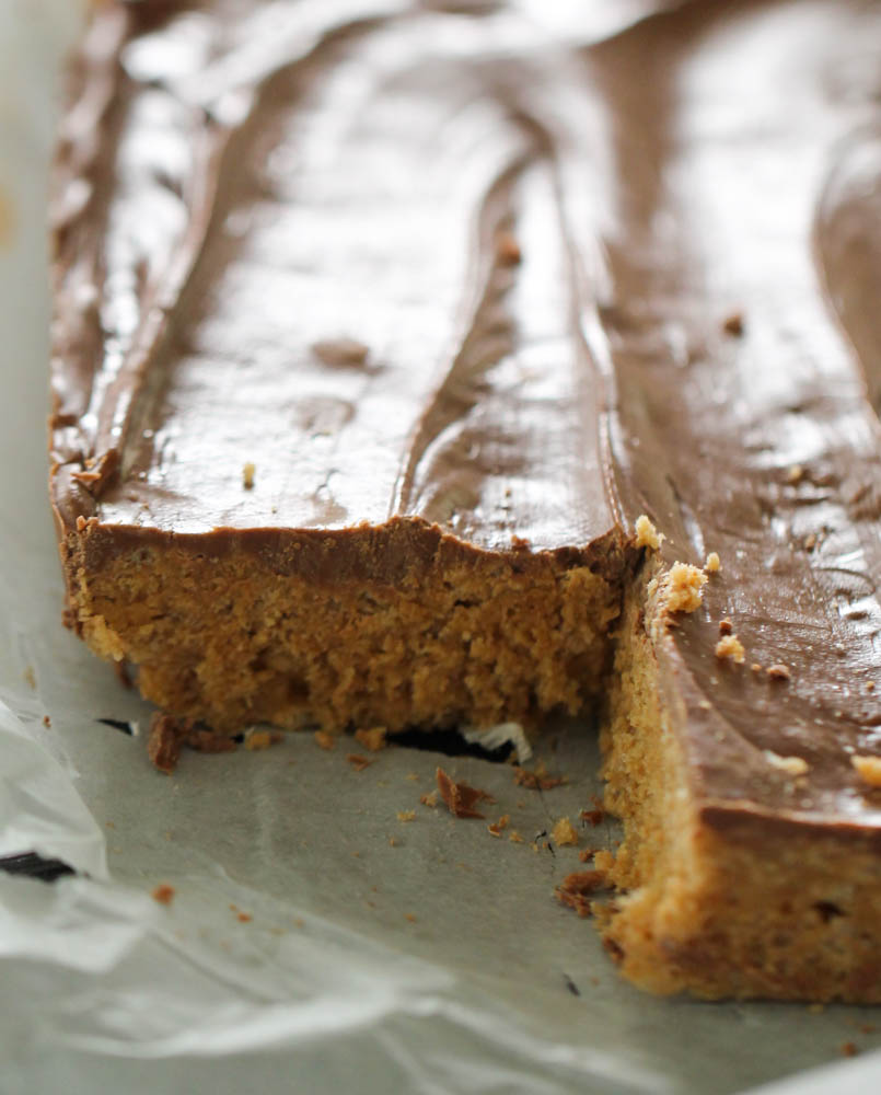No Bake Scotcheroos in a pan with the corner slice missing