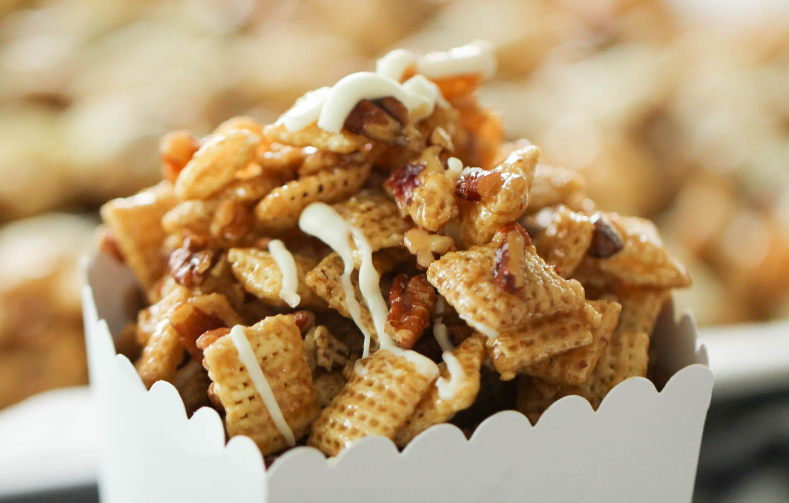 pecan pie chex mix in a white cardboard container