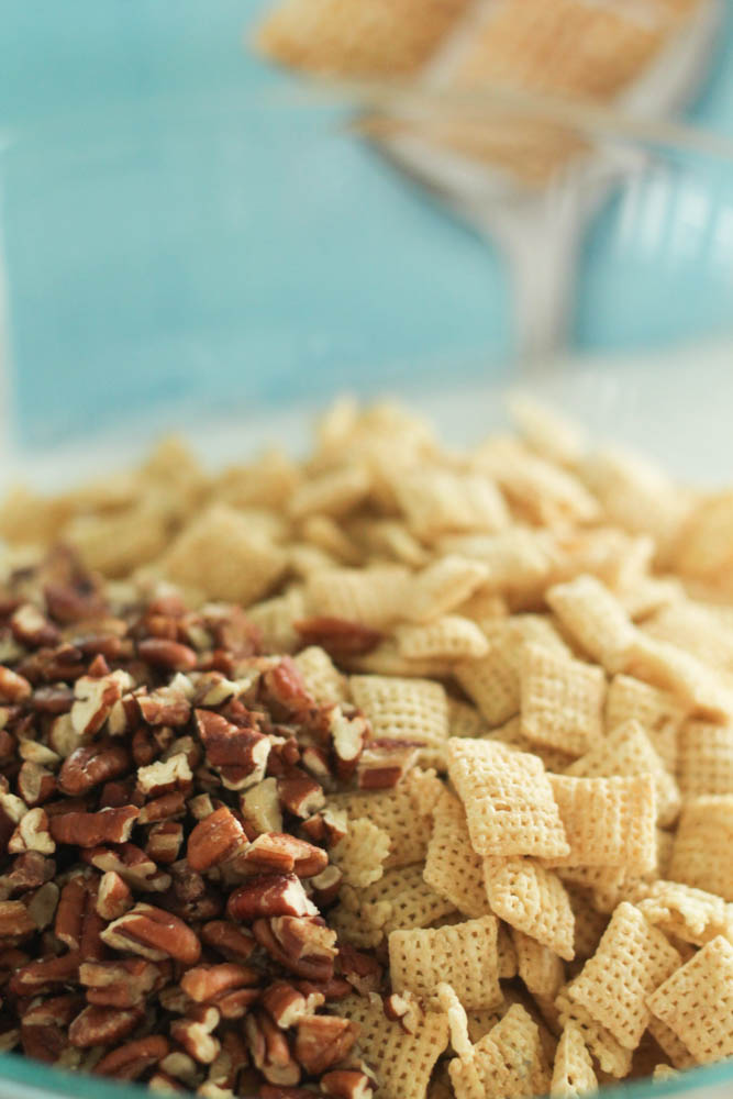 pecans and chex mix in a bowl