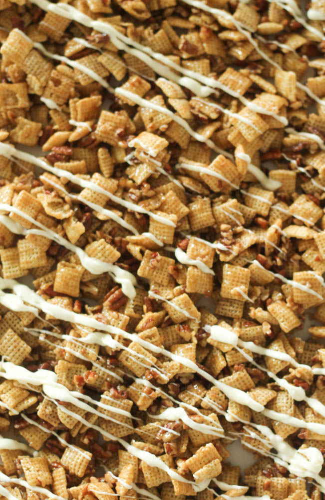 caramel chex mix with pecans and drizzled with white chocolate