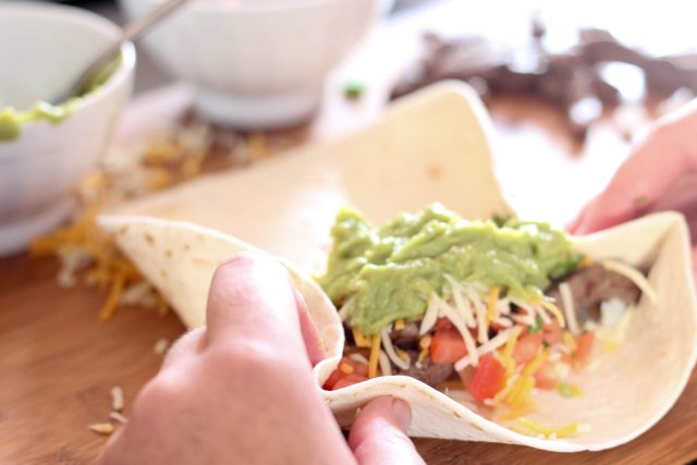 Filling the burrito with toppings