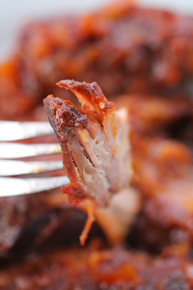 Fork with a piece of Slow Cooker BBQ Country Style Ribs