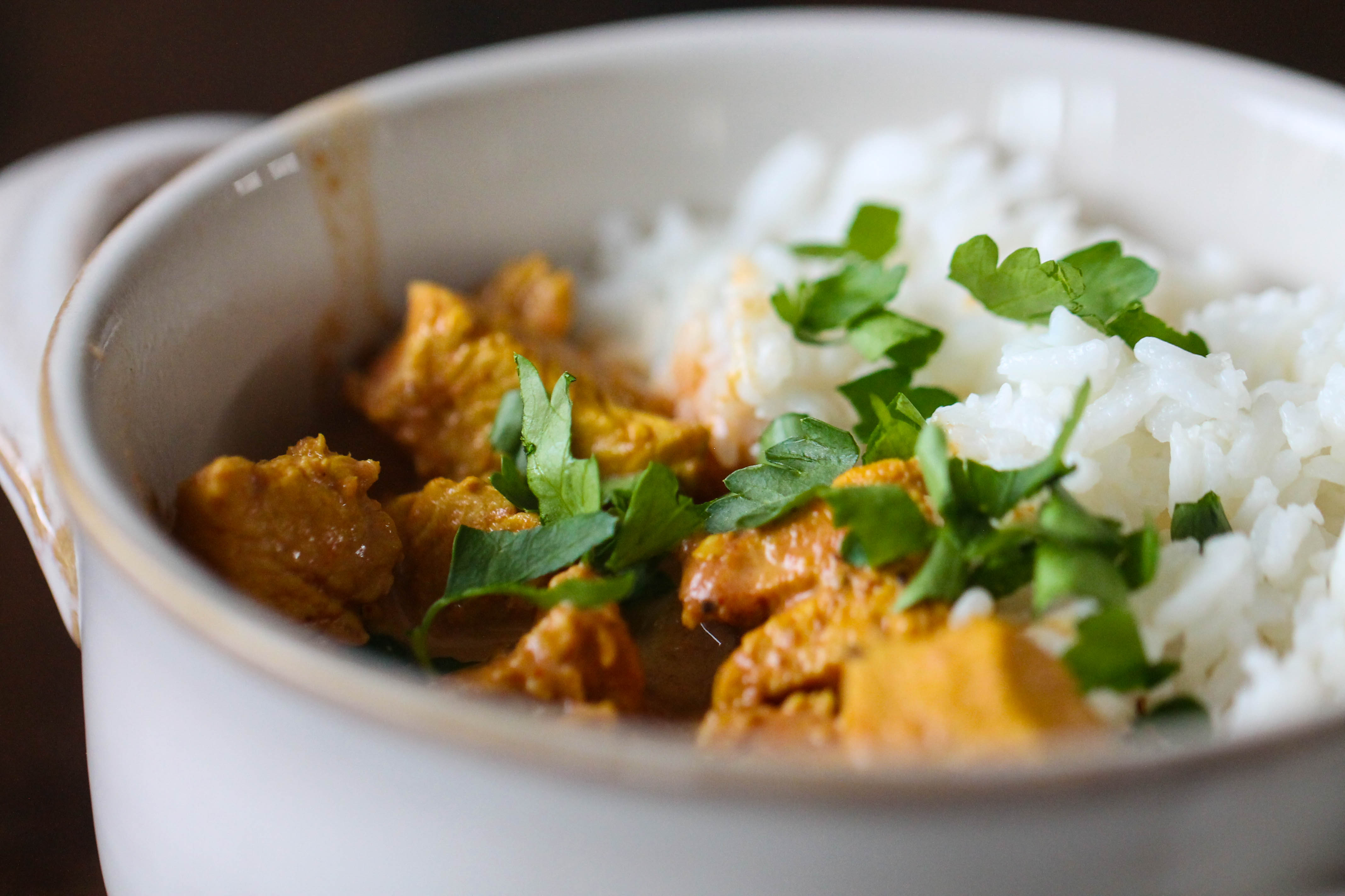 Cooked chicken tikka masala in bowl with rice