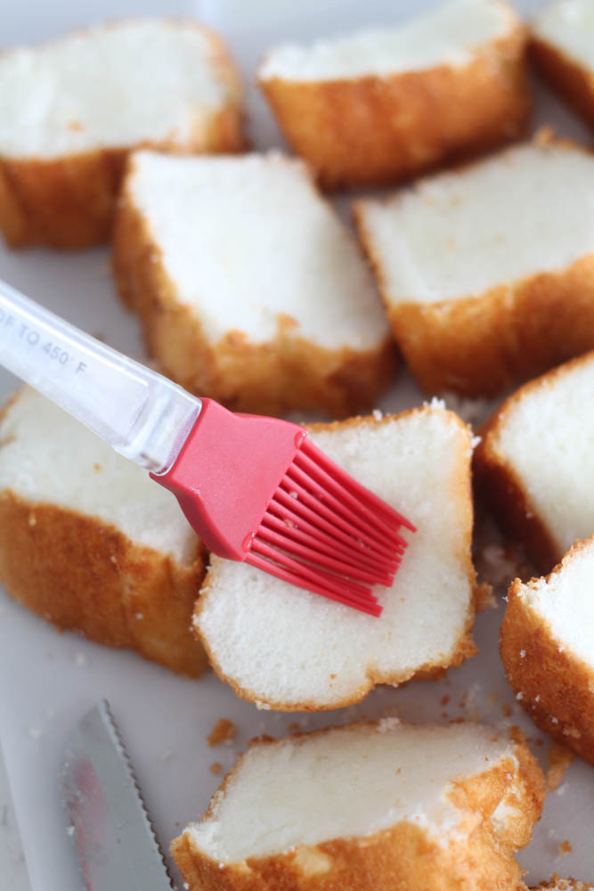 Brushing lemon glaze on Angel Food cake slices