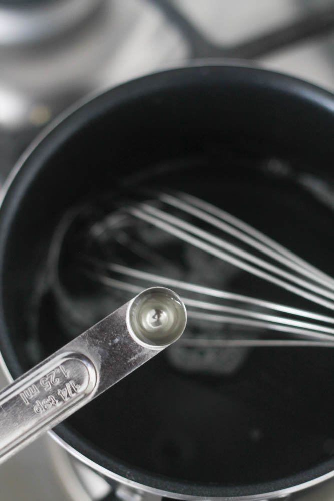 Glaze ingredients in a sauce pan with a measuring spoon