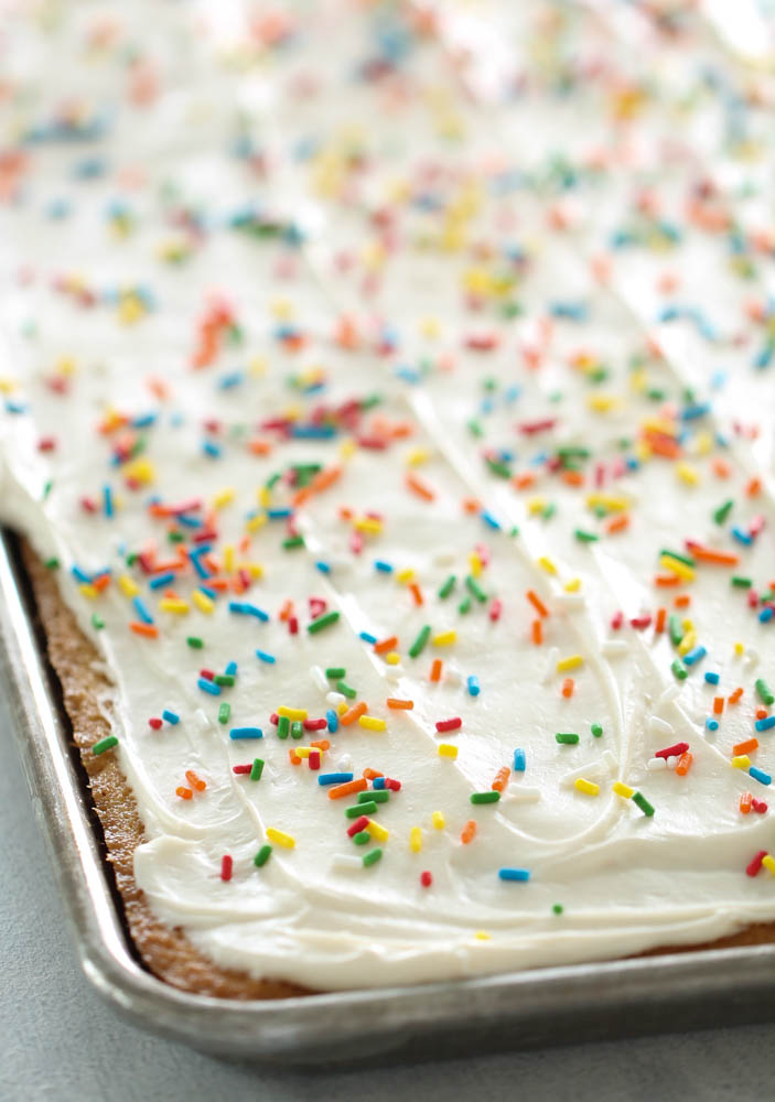 White Texas Sheet Cake with frosting and sprinkles