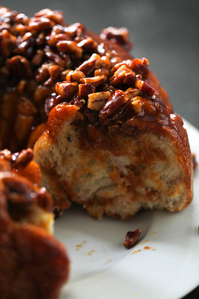 the gooey caramel pull apart with a piece cut out so you can see the soft, cooked inside