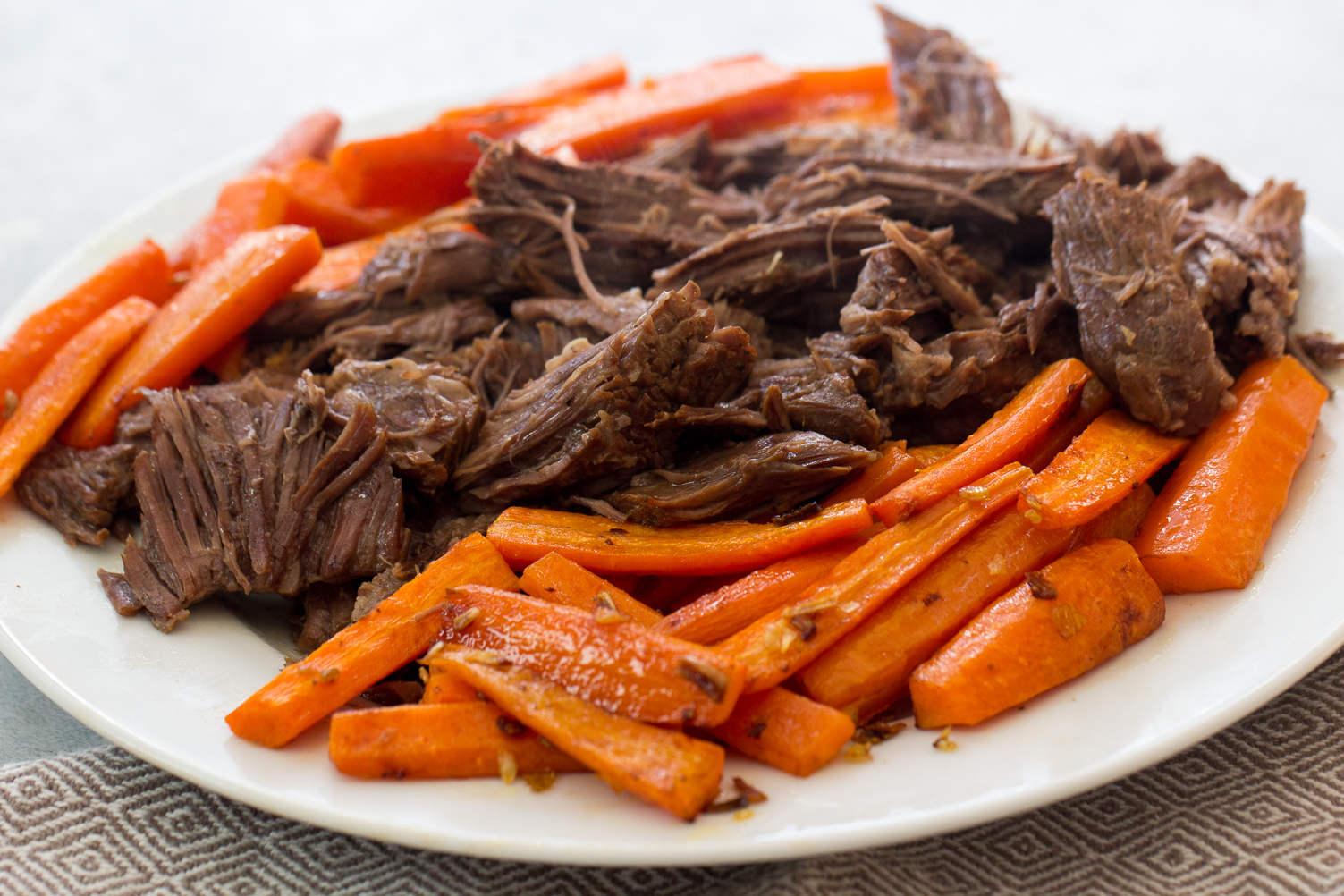 Instant Pot Italian Beef Roast on plate shredded with carrots