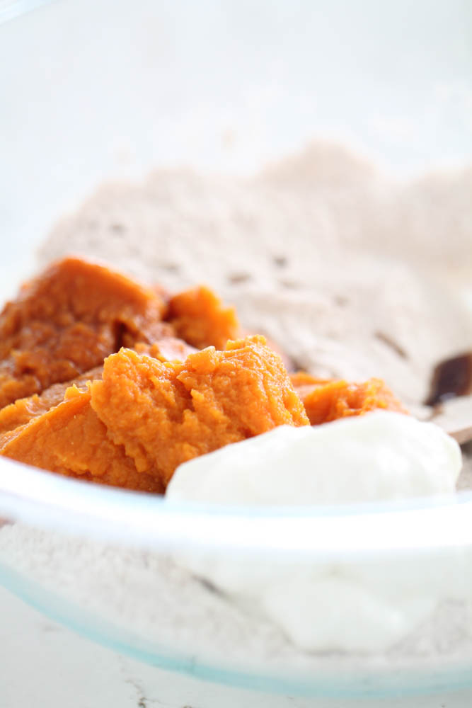 Ingredients for Pumpkin Spice Muffins in glass mixing bowl