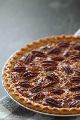 Easy Pecan Pie in pan on a towel