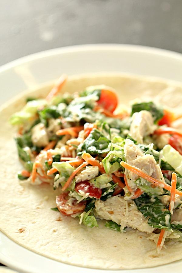10 Minute Healthy Chicken Caesar Salad Wrap filling on a tortilla
