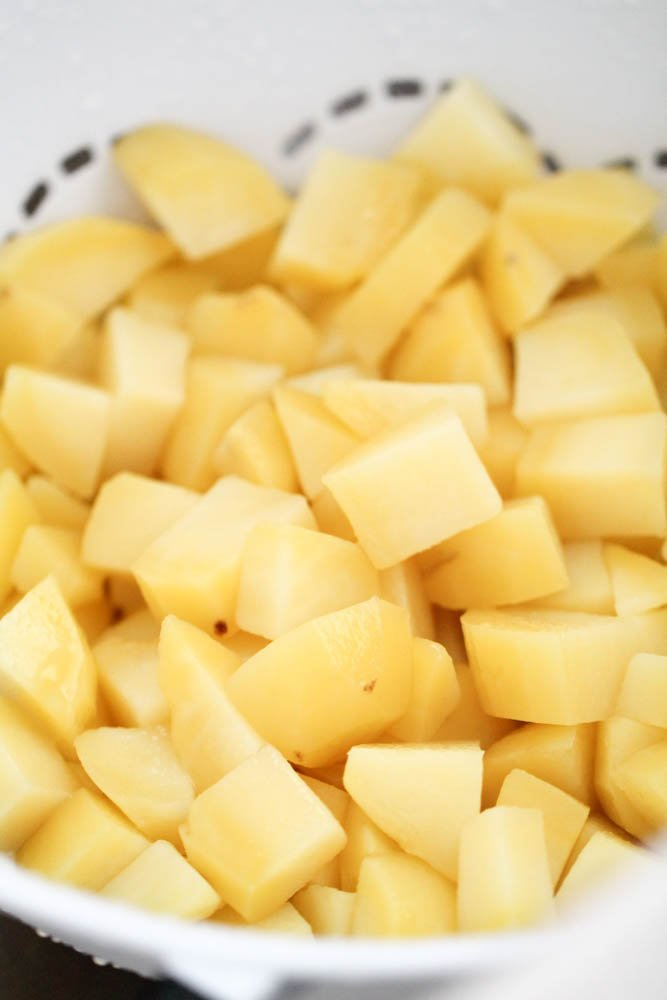 Cubed potatoes in a large pot