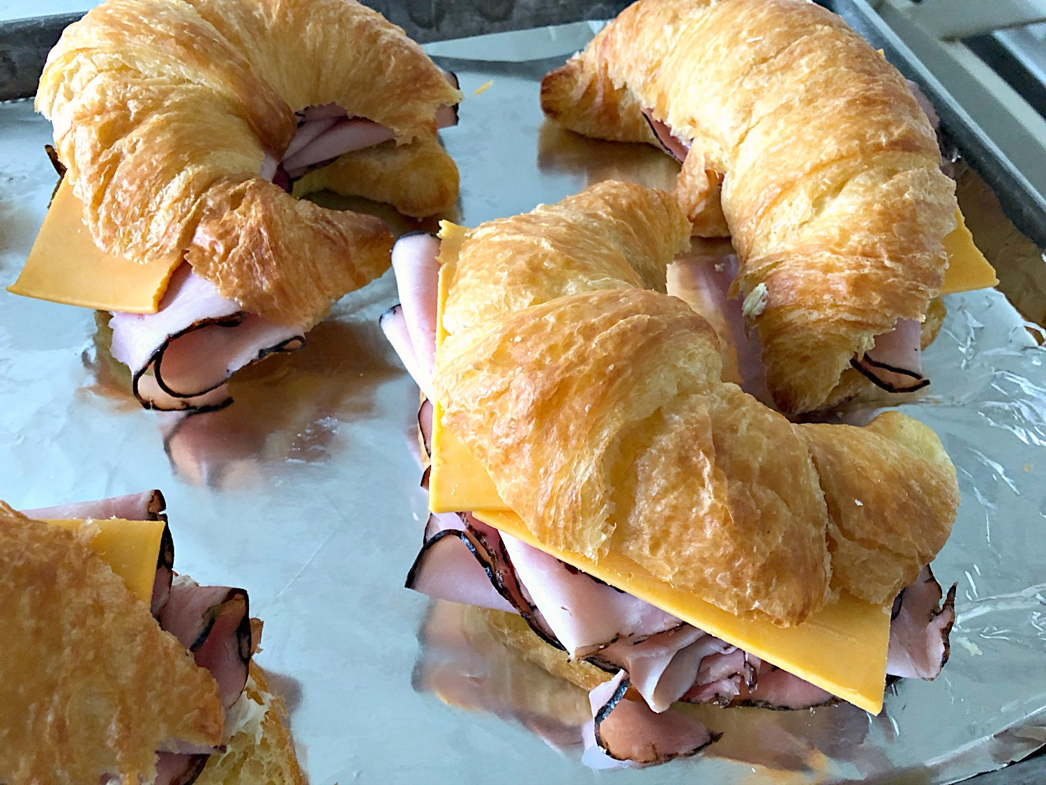 Ham and Cheese Croissant Sandwiches on sheet pan ready to bake