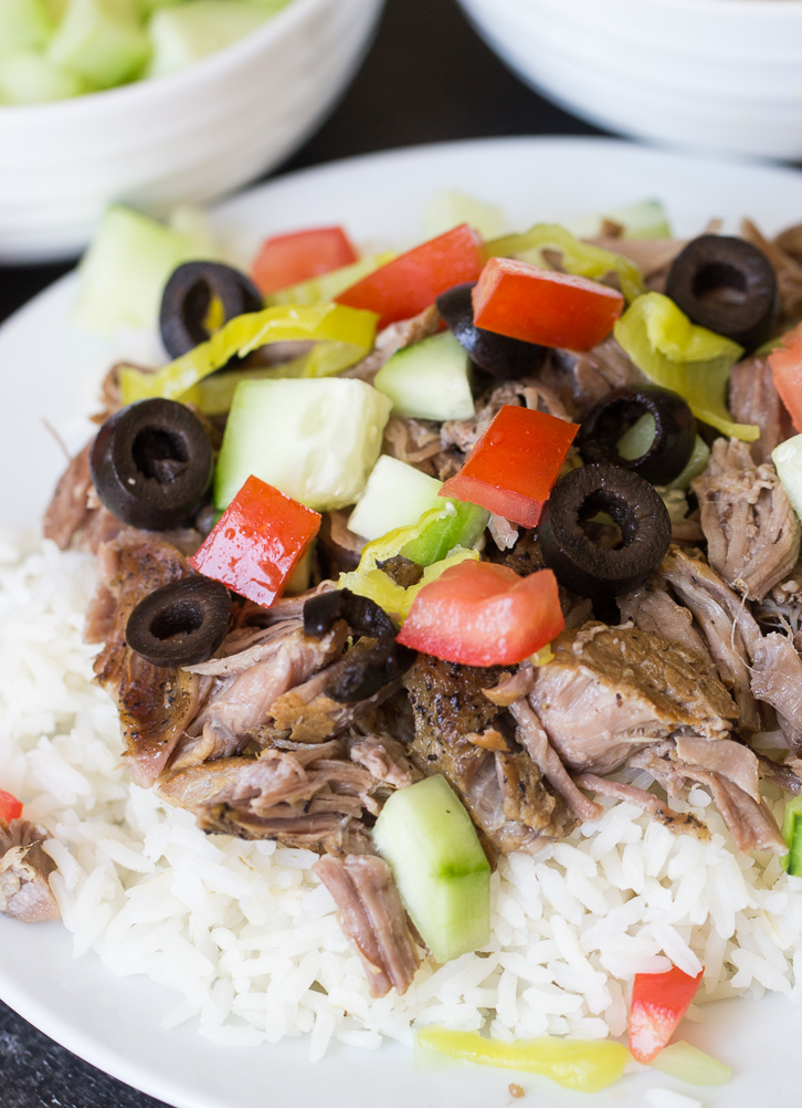 Instant Pot Kalua Pork served over rice and topped with vegetables