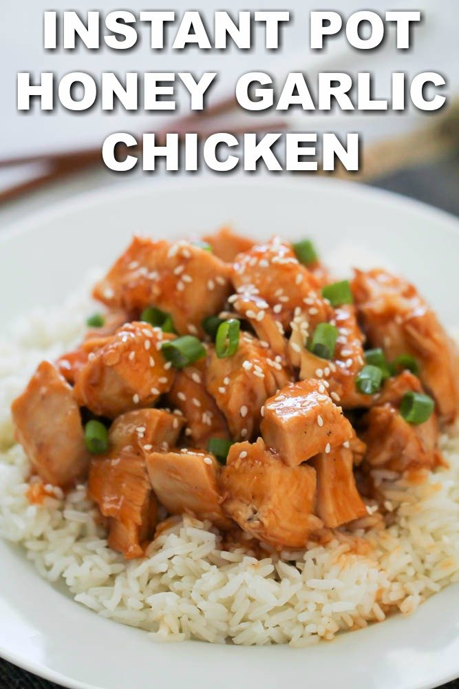 instant pot honey garlic chicken over rice with green onions and sesame seeds on top