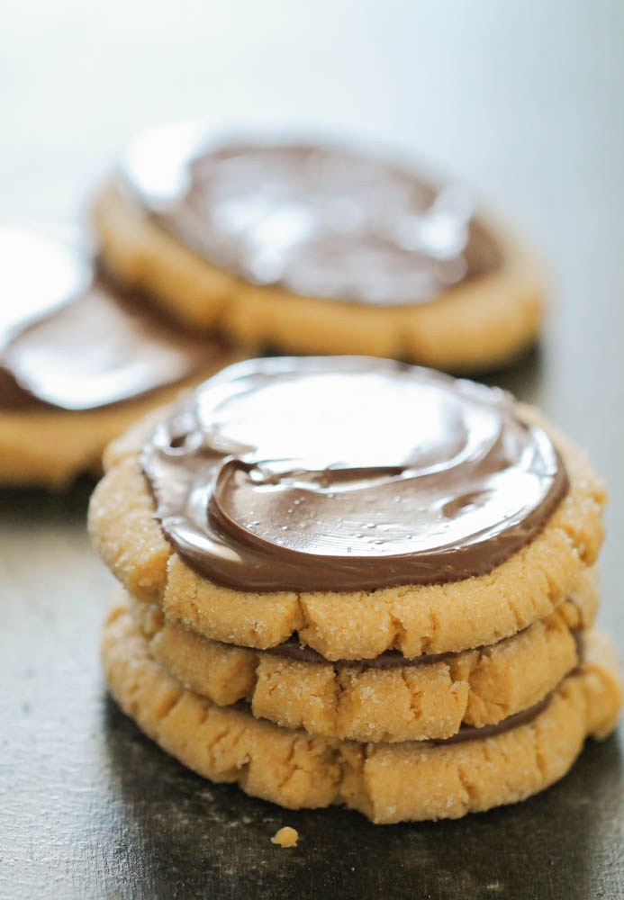 stack of 3 peanut butter cookies frosted with nutella hazelnut spread on top