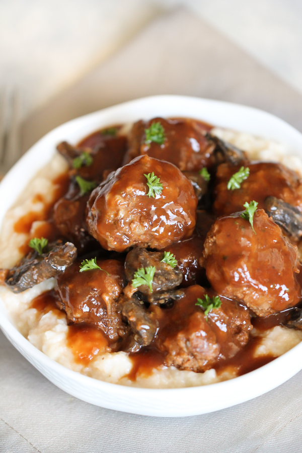 Salisbury Steak Meatballs served over rice in a white bowl