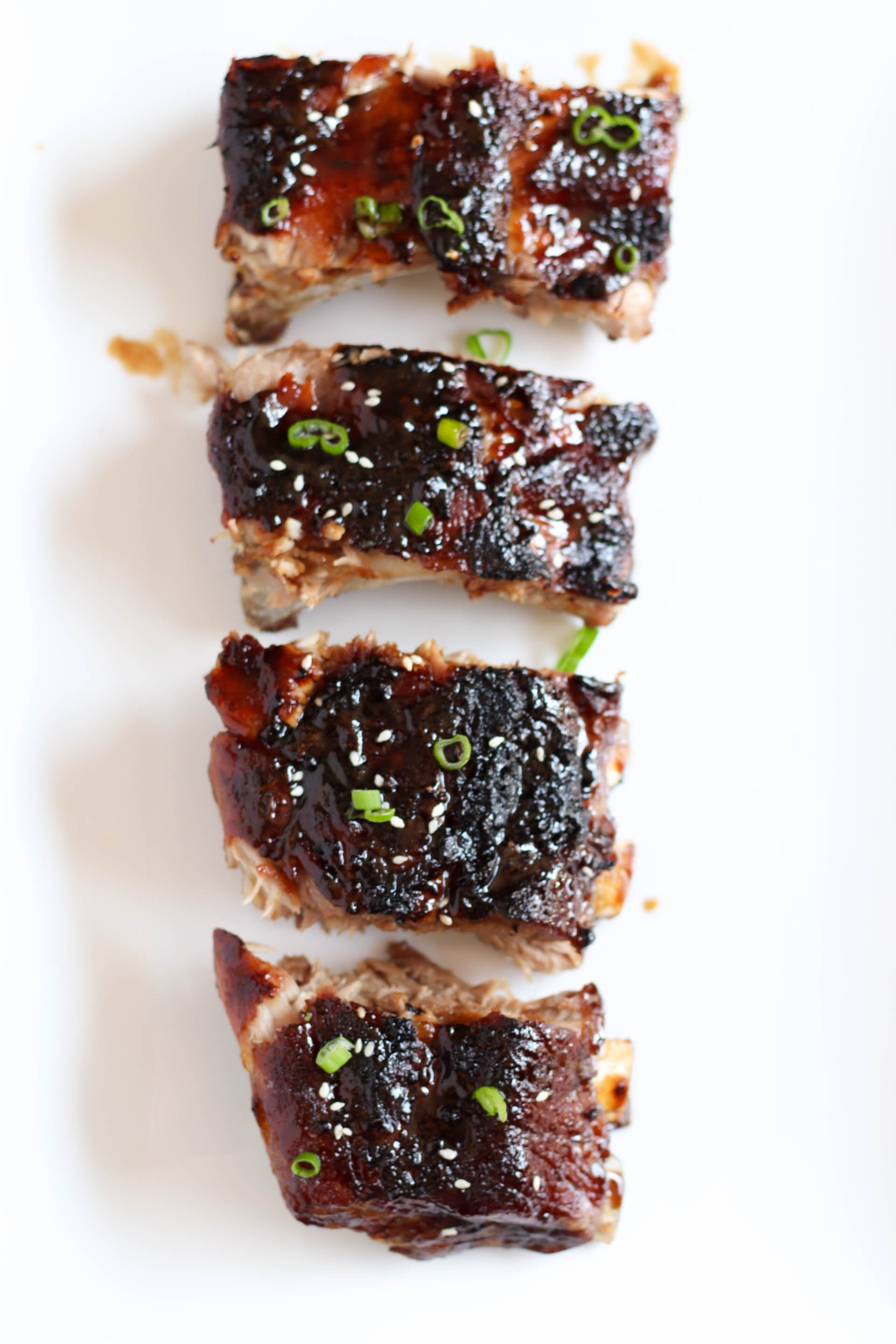 Sticky Asian Ribs sliced on a white plate