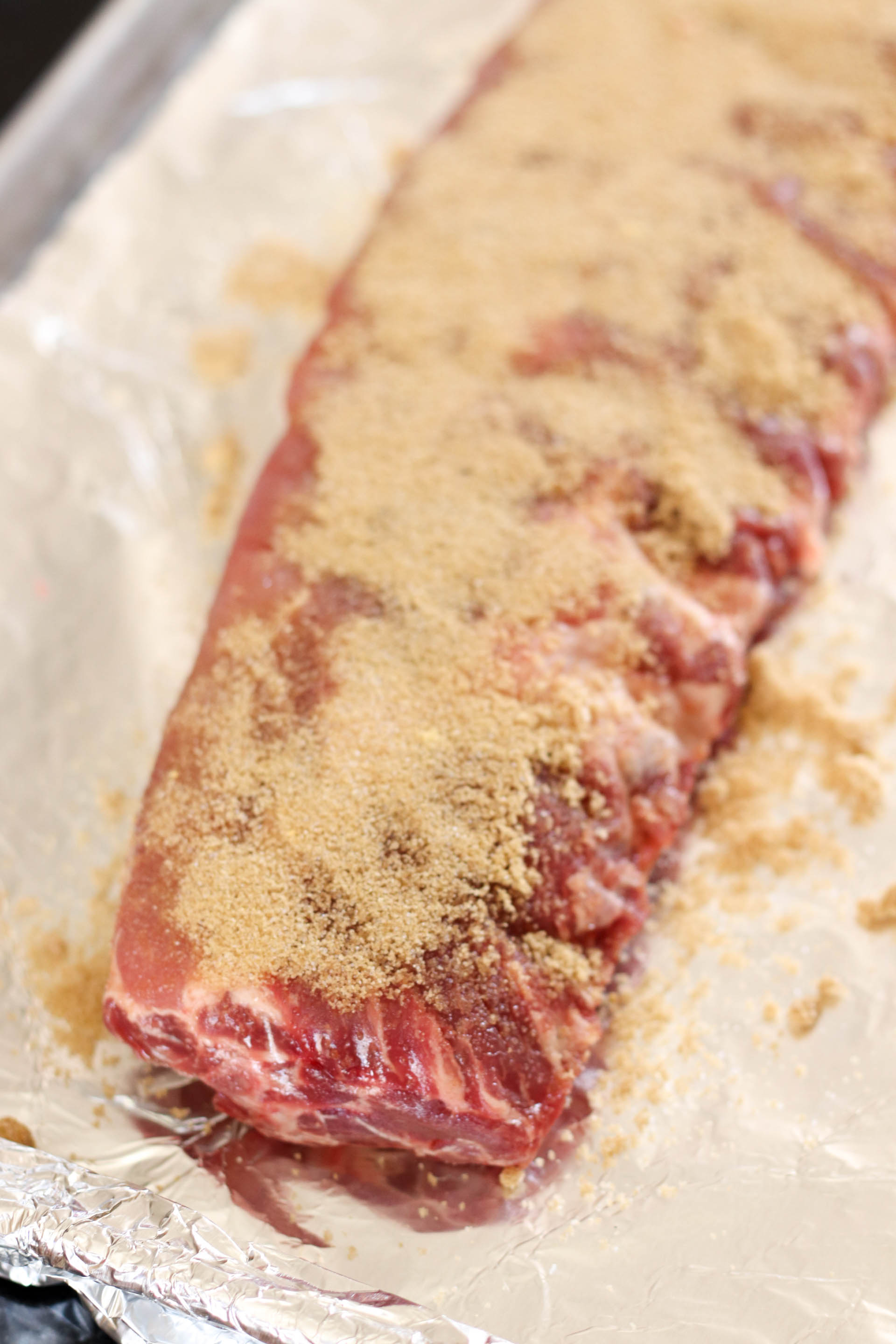 Uncooked ribs with Brown sugar rub all over them