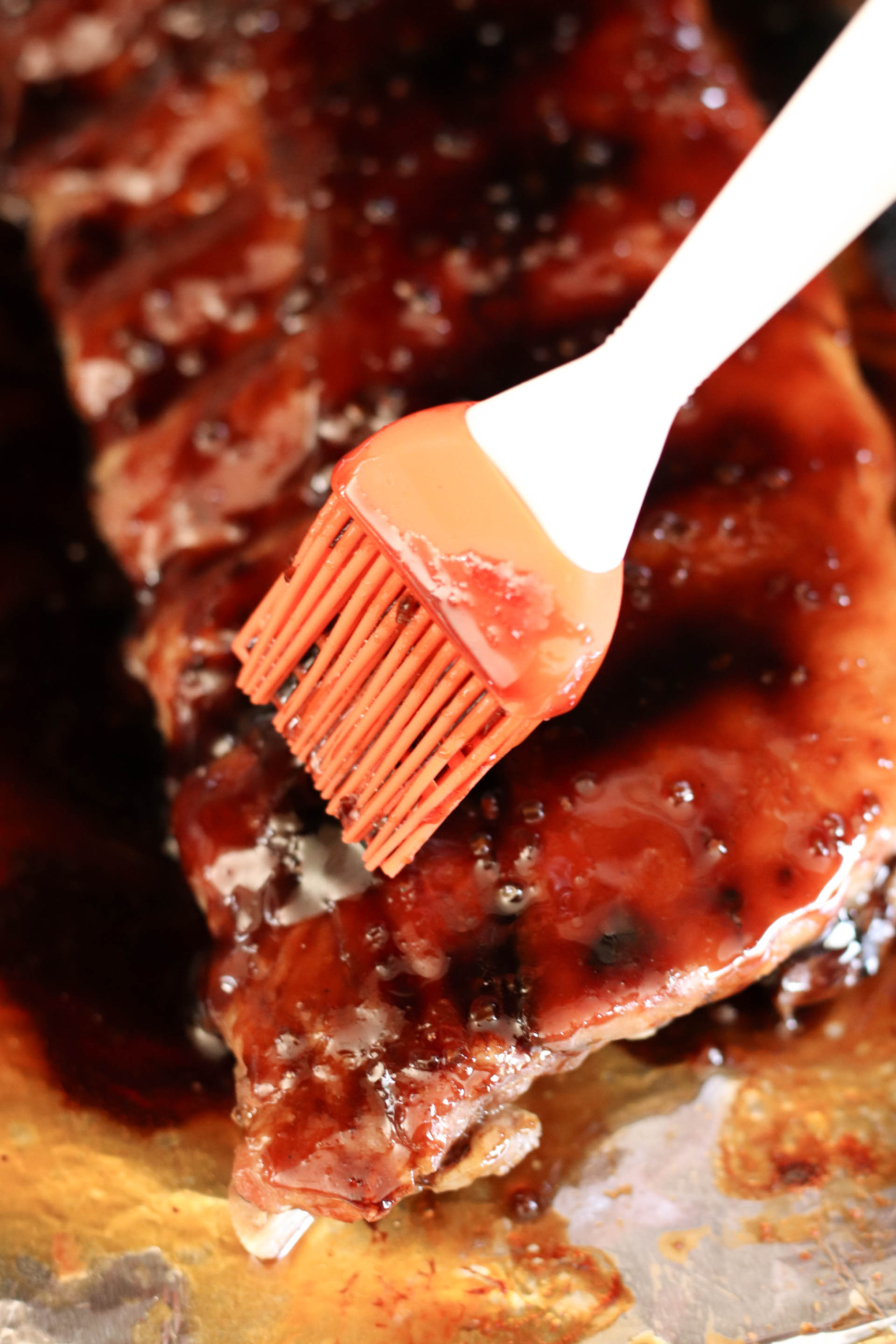 Brushing sticky sauce on ribs