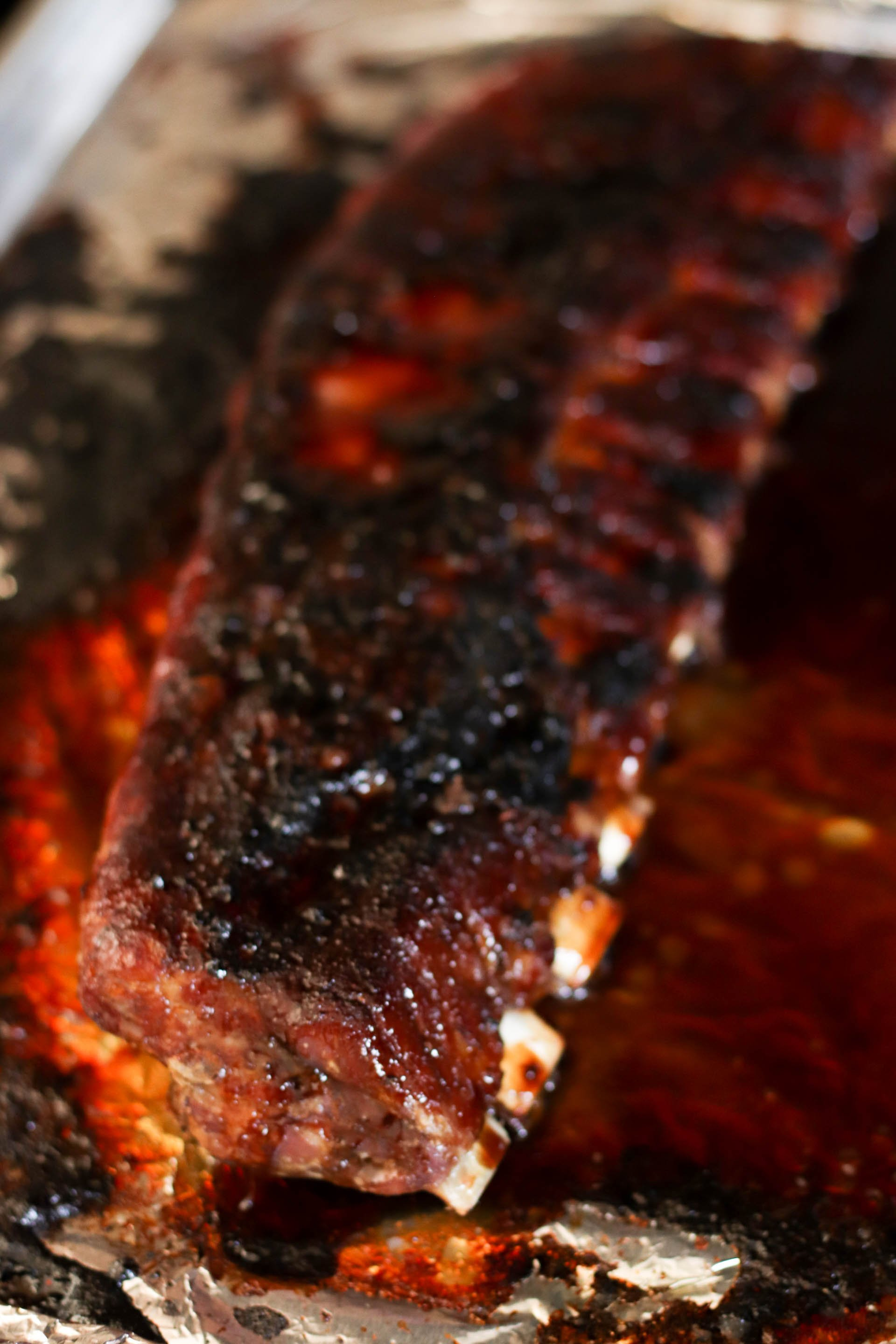 Sticky Asian Ribs on the grill on top of foil