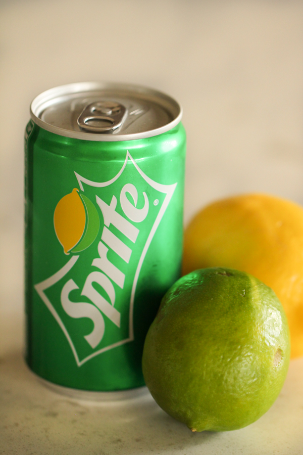 Can of sprite with a lemon and lime