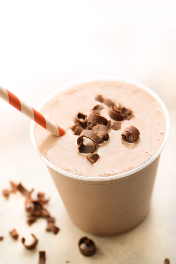 Copycat Wendy's Chocolate Frosty Recipe with chocolate shavings on top and red white strip straw