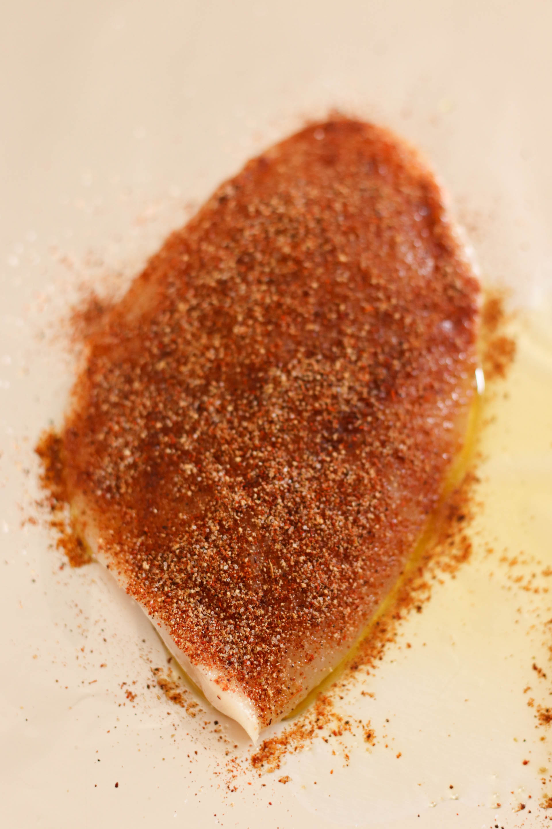 Rub spice mixture on uncooked chicken breast