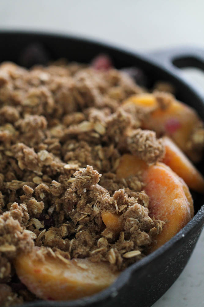 Peach and Berry Crisp in a skillet